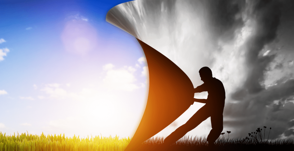 Man pulling a curtain to reveal a sunny day when he is standing in a gloomy picture